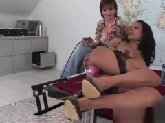 Ebony milf inserts toy in her juicy cunt