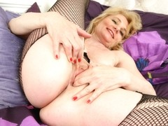 British milf Diana gets naughty in fishnet tights