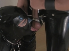 Rubber Shemale Sex Slave in chains, taking cock deep down