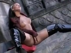 Lesbians in boots dominate ginger slut with a strapon