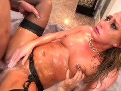 Carter Cruise is drenched in oil and fucked