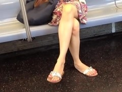 Candid crossed legs and sandal dangling