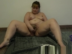 pushes a pear out of a hairy cunt and masturbates, mature beautiful BBW