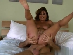 Tempting buxomy mom receiveing a cumshot on her face