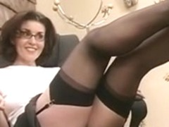 Hawt brunette hair with glasses and nylons widens and toys her love tunnel with a fake penis