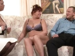 Red haired, German mature is bouncing up and down while fucking a guy she likes