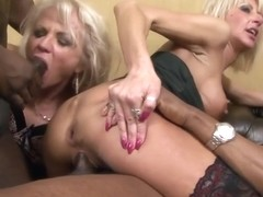 Blonde whores are sucking big, black dicks and getting fucked hard, during an interracial foursome