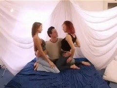 being smothered and filmed by two hot chicks