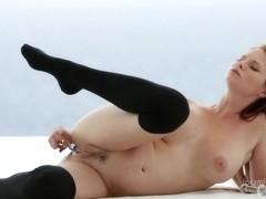Tarra White is a hot redhead masturbating by the pool