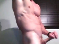 Muscled Guy Lubes His Cock and Jerks Off