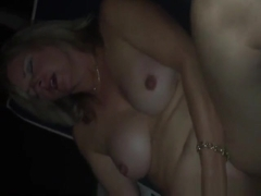 Fat busty mature blonde using a massive vibrator to masturbate