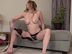 Single mature blonde playing with her toy