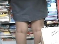Upskirt sexy thong of the real bookworm in library