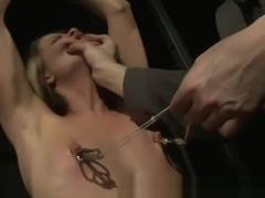 BDSM lezdom uses clamps on subject in hot high def