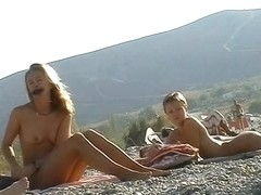 Several sexy nude girls caught on a beach with a spy cam
