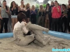 European hotties enjoy wrestling in mud