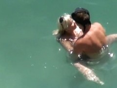 Horny couple having sex on a beach