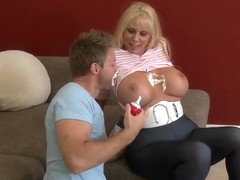 Cream looks appetizing on the tits of lazy blonde
