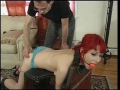 Tiny boobs redhead gagged & tied for a drubbing session