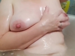 mom washes big tits