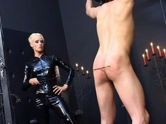 Female-Dom in latex catsuit torturing poor villein
