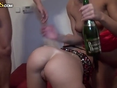 Sticking green beer bottle into Abilia's ass