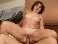 Nasty old slut Marsha seduced some young freaky guy to have a fuck with her, she sucked his dick and fucked it.
