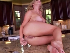 Yummy hot blonde chick Ainsley Addison is having naughty masturbation on the kitchen counter with fruits.