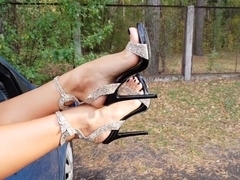 Hot girls shows her perfect feet on high heels