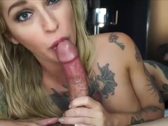 Stunning inked beauty giving a BJ
