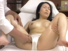 Asian slut receives a real wet pussy massage in voyeur movie