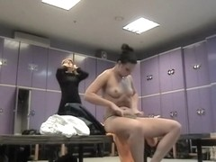 Naked bimbo is oiling her body on dressing room spy cam