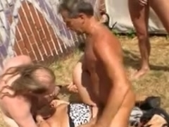 Sexy and a busty mature MILF fucked on the beach