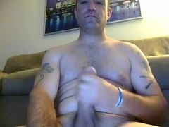 Sweet guy is having a good time in the apartment and shooting himself on computer webcam