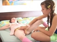 Teen Isabel on the bed with her friend Diana