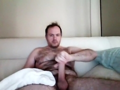Juicy male is having fun in the guest room and filming himself on webcam