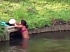 Chubby Brazilian chick takes a quick swim in the local river