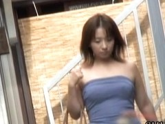 Busty Asian babe boob gets sharking on the street.