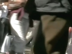 Bubble butt honey in tight white pants stars in a candid street vid