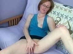 Nerdy Looking Redhead Fingering Her Cunt