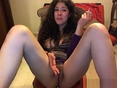 The girl plays with her pussy on the room