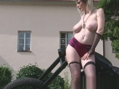 Biker girl showws off her desirable big tits