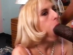 White golden-haired honey on her knees with huge darksome ramrod in her throat