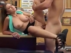 Busty woman screwed by horny pawn keeper in the backroom