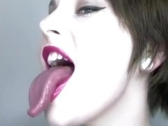 Her tongue is a actually weird color yet strangely arousing