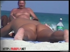 Naked tanned pussies acting horny at the beach