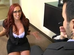 Redhead secretary with big boobs was caught by her boss with porn videos