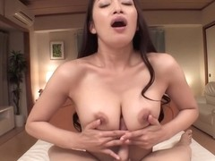 Reiko Kobayakawa is rubbing her lovers dick with her boobs to make him explode from pleasure