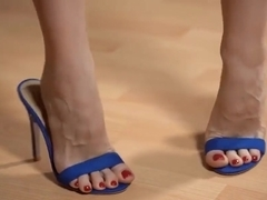 Shoeplay, dangling, in blue mules. Close-up. Yum !