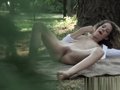 European model pleasuring her pussy outdoors